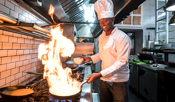 Chef flaming food at a restaurant