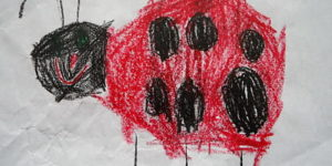 A child's drawing of a ladybug